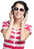 Young girl with earphones Stock Photos