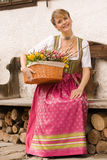 Young girl with Easter bouquet Bavarian Stock Image