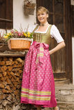 Young girl with Easter bouquet Bavarian Royalty Free Stock Image