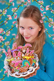 Young girl with easter gingerbread cookies Royalty Free Stock Image