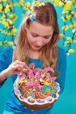 Young girl with easter gingerbread cookies Stock Image