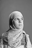 Young girl in eastern scarf Stock Photos