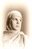 Young girl in eastern scarf Royalty Free Stock Photos