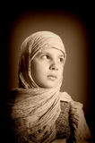Young girl in eastern scarf Stock Images