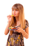 Young girl eat fruit jelly isolated Royalty Free Stock Images
