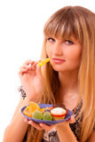 Young girl eat fruit jelly isolated Stock Photos