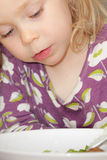 Young girl eating Royalty Free Stock Photos