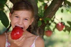Young girl eating an apple Stock Photo