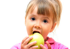 Young girl eating apple Stock Photos