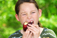 Young girl eating apple Stock Photo