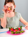 Young girl eating berries Stock Photo