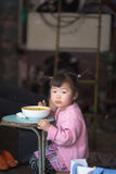 Young girl Eating on a blue table in Shanghai Stock Photos