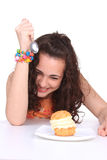 Young girl eating cake Stock Photos