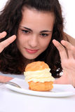 Young girl eating cake Royalty Free Stock Photos