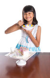 Young Girl Eating Cake II Stock Image