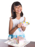 Young Girl Eating Cake III Stock Images