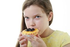 Young girl eating cake Royalty Free Stock Image