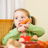 Young girl eating a carrot Royalty Free Stock Photo