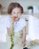 Young girl eating carrot Stock Image