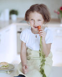 Young girl eating carrot Royalty Free Stock Image