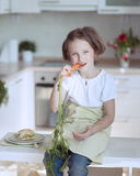 Young girl eating carrot Stock Photography