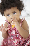 Young Girl Eating Carrot Stick Stock Photo