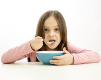 Young girl eating cereal Stock Photography