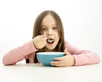 Young girl eating cereal Royalty Free Stock Image