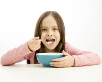 Young girl eating cereal Royalty Free Stock Photography