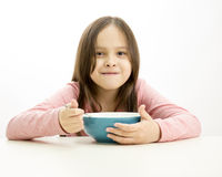 Young girl eating cereal royalty free stock photos