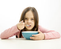 Young girl eating cereal Royalty Free Stock Photo