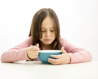 Young girl eating cereal Stock Image