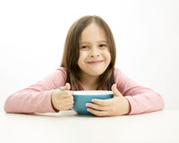 Young girl eating cereal Royalty Free Stock Images