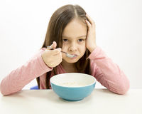Young girl eating cereal Stock Images