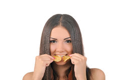 Young girl eating chips Royalty Free Stock Photo