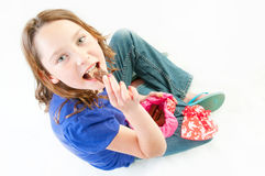 Young girl eating chocolate Royalty Free Stock Photos