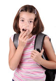 Young girl eating chocolate Stock Photography