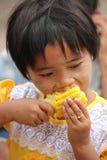 Young girl eating cob Stock Image