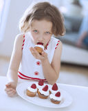 Young girl eating cup cake Stock Photo