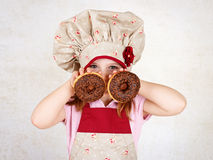 Young girl eating donuts Stock Photo