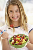 Young Girl Eating Fresh Fruit Salad Royalty Free Stock Images