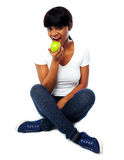 Young girl eating fresh green apple Stock Photos