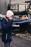 Young girl eating freshly prepared crepes which are thin pancakes with chocolate spread filling outside at Christmas market. royalty free stock photography