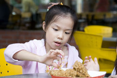 Young Girl Eating Fried Chicken Royalty Free Stock Photo