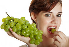 Young girl eating a grape Royalty Free Stock Images