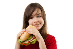 Young girl eating healthy sandwich Royalty Free Stock Photo