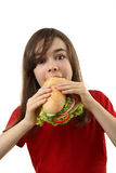 Young girl eating healthy sandwich Stock Photos
