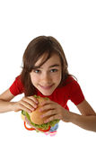 Young girl eating healthy sandwich Royalty Free Stock Photos