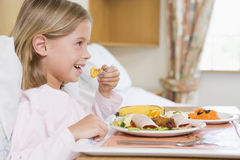Young Girl Eating Hospital Food Stock Photo