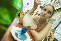 Young Girl Eating Ice Cream Outside Royalty Free Stock Photos